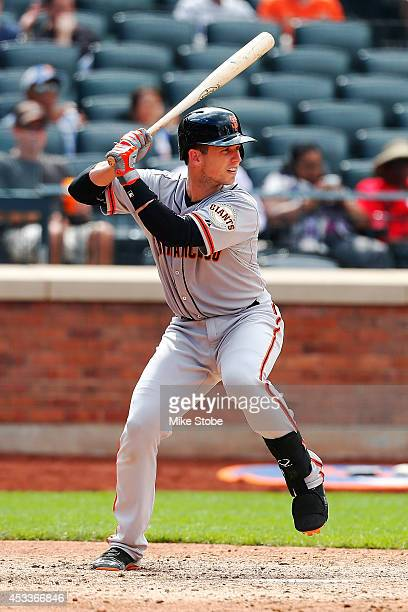 Buster Posey of the San Francisco Giants looks in action against the New York Mets at Citi Field on August 4, 2014 in the Flushing neighborhood of...
