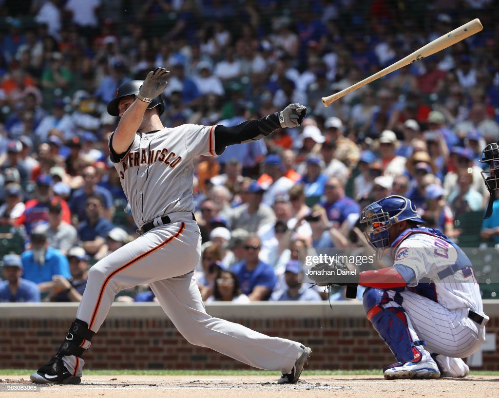 Buster Posey #28 of the San Francisco Giants looses his bat hitting against the Chicago Cubs at Wrigley Field on May 25, 2018 in Chicago, Illinois. The Cubs defeated the Giants 6-2.