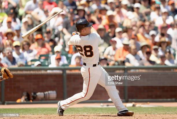 Buster Posey of the San Francisco Giants looses his bat while batting during their game against the Arizona Diamondbacks at ATT Park on May 30 2010...