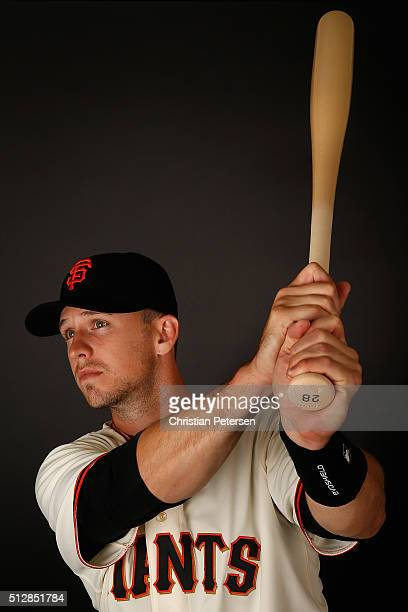 Buster Posey of the San Francisco Giants poses for a portrait during spring training photo day at Scottsdale Stadium on February 28, 2016 in...