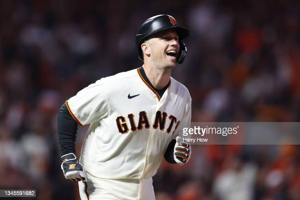 Buster Posey of the San Francisco Giants reacts after hitting a two-run home run off Walker Buehler of the Los Angeles Dodgers during the first...