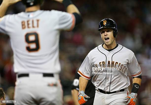 Buster Posey of the San Francisco Giants reacts as he crosses home plate after hitting a two-run home run against the Arizona Diamondbacks during the...