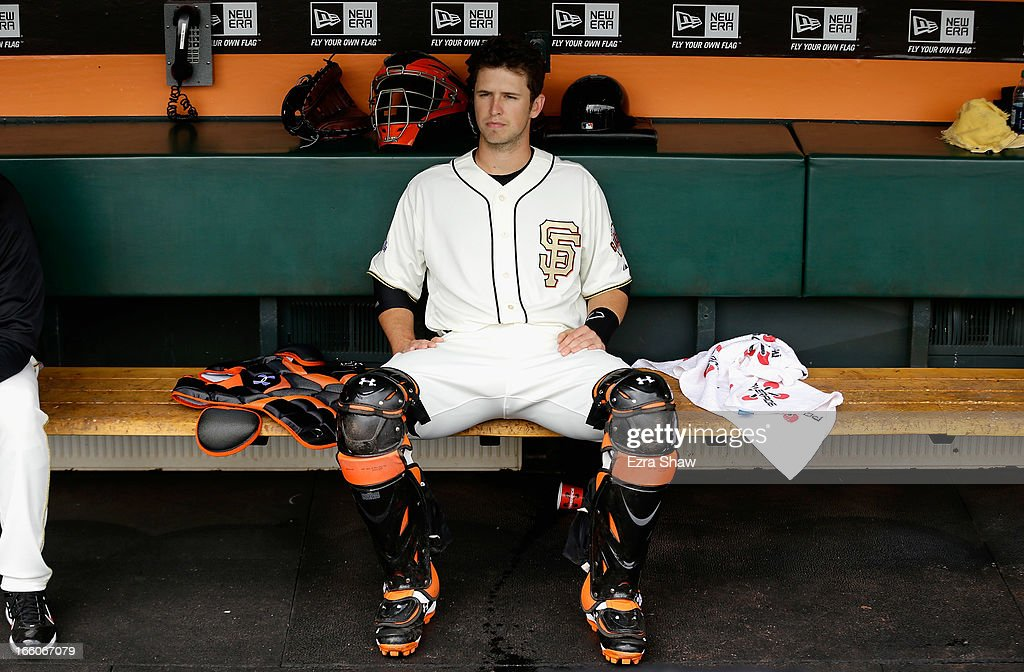 Buster Posey #28 of the San Francisco Giants sits in the dugout before their game against the St. Louis Cardinals at AT&T Park on April 7, 2013 in San Francisco, California.
