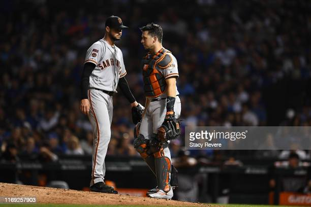 Buster Posey of the San Francisco Giants speaks with Tyler Beede during the fourth inning against the Chicago Cubs at Wrigley Field on August 20 2019...