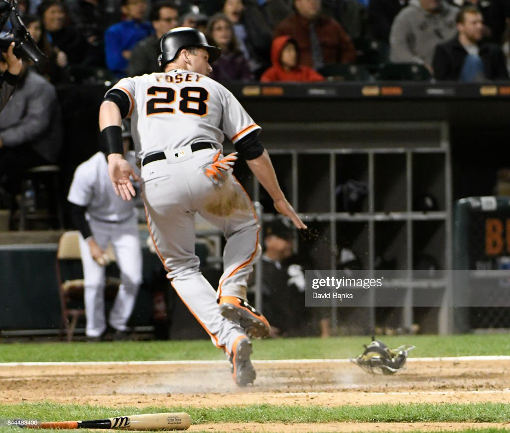 Buster Posey #28 of the San Francisco Giants steals home against the Chicago White Sox during the sixth inning on September 8, 2017 at Guaranteed Rate Field in Chicago, Illinois.