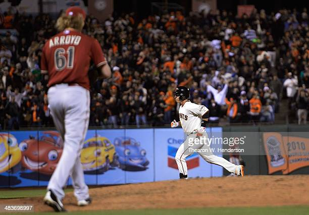 Buster Posey of the San Francisco Giants trots around the bases after hitting a solo home run off of Bronson Arroyo of the Arizona Diamondbacks in...