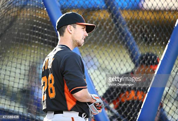 Buster Posey of the San Francisco Giants waits for his turn in the batting cage during batting practice prior to the MLB game against the Los Angeles...