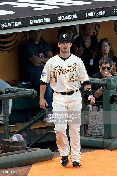Buster Posey of the San Francisco Giants walks on to the field during the 2014 World Series ring ceremony before the game against the Arizona...
