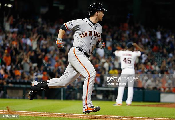 Buster Posey of the San Francisco Giants watches a tworun home run in the fifth inning off pitcher Samuel Deduno of the Houston Astros at Minute Maid...