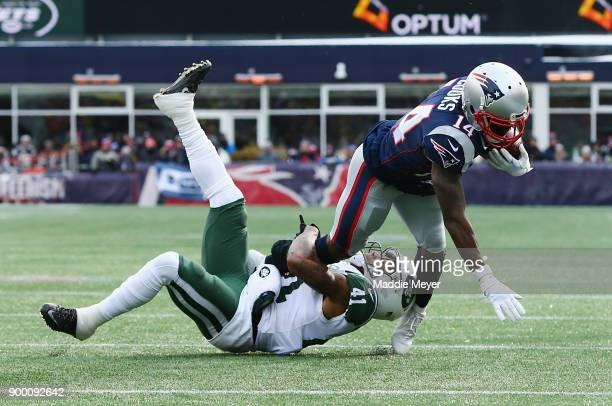 Buster Skrine of the New York Jets tackles Brandin Cooks of the New England Patriots during the first half at Gillette Stadium on December 31 2017 in...