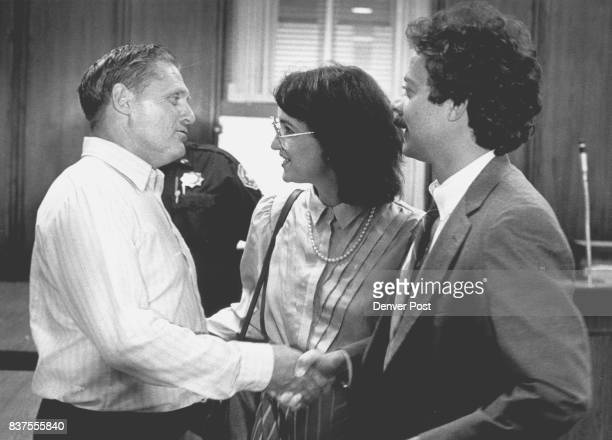 Buster Snider is congratulated by his lawyer Buster Snider shakes hands with his attorney Stave Polidori right and is congratulated by Terri Brake...