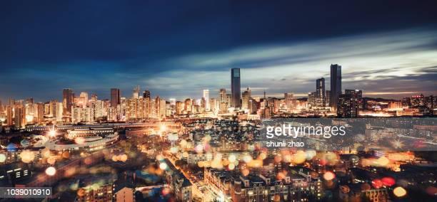 bustling city - イルミネーション ストックフォトと画像