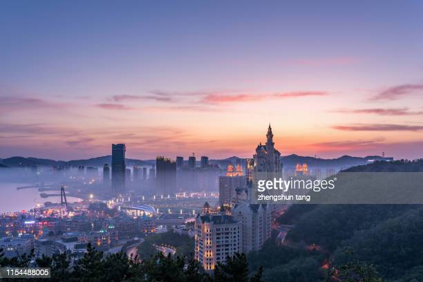 bustling city - dalian stock photos and pictures