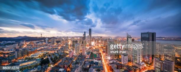 bustling dalian - zhongshan stock-fotos und bilder