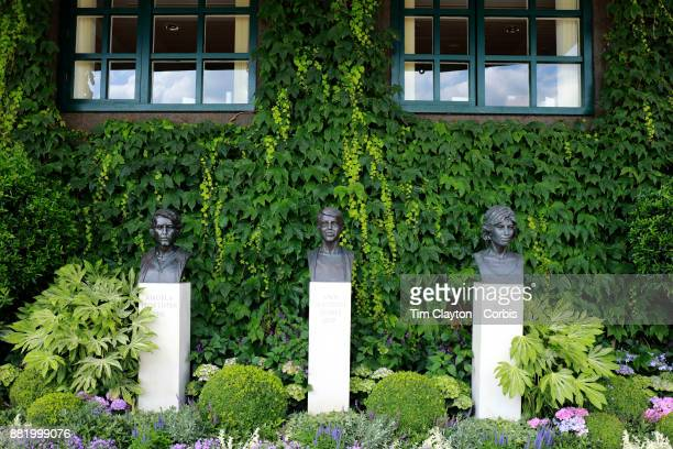 Busts of Angela Mortimer Ann Haydon Jones and Virginia Wade outside Centre Court during the Wimbledon Lawn Tennis Championships at the All England...