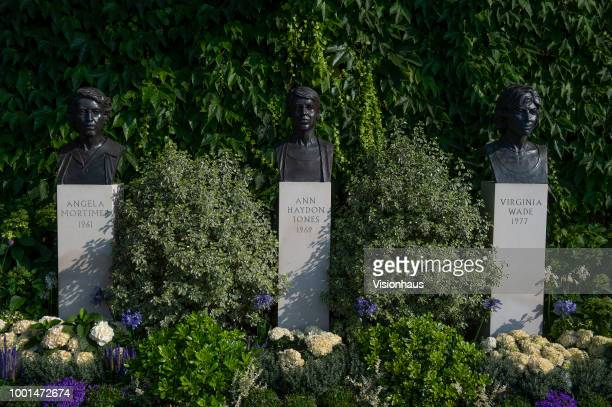 Busts of Angela Mortimer Ann Jones and Virginia Wade outside the main entrance of the All England Club on day twelve of the Wimbledon Lawn Tennis...
