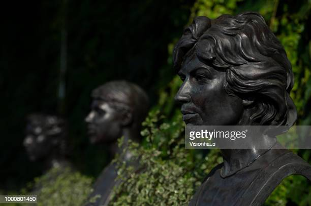 Busts of former Ladies' Singles Champions Angela Mortimer Ann Jones and Virginia Wade outside the main entrance of the All England Club on day...