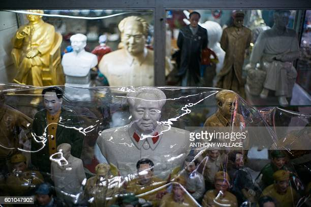 Busts of Mao Zedong are displayed at a stall in Hong Kong on September 9 which marks 40 years since Mao's death in 1976. Throngs of pilgrims lined up...
