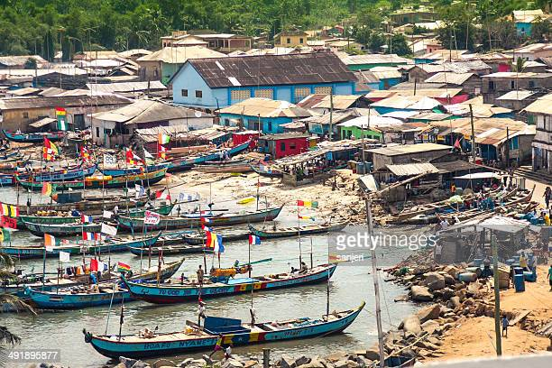 busua, fisherman village in ghana, africa - ghanaian flag stock photos and pictures