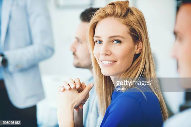 buswinesswoman in a meeting. - blue eyes stock pictures, royalty-free photos & images