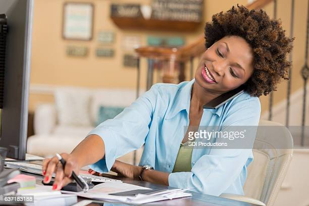 Busy African American woman works from home