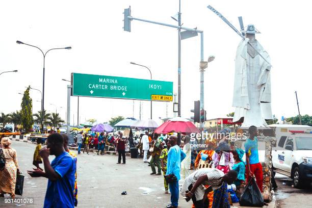 busy african city - lagos, nigeria - nigerian police forces stock photos and pictures