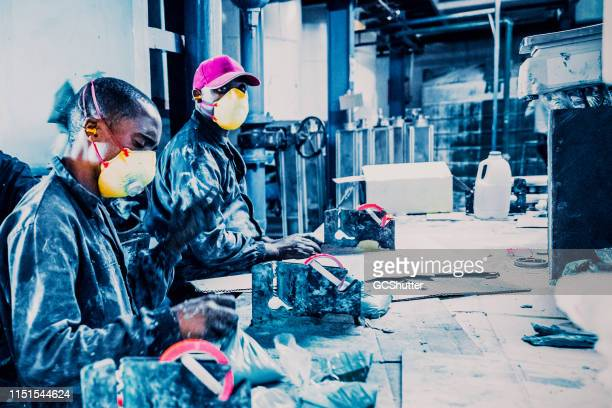 busy african manual workers working at a soap paste factory in africa - may day stock pictures, royalty-free photos & images