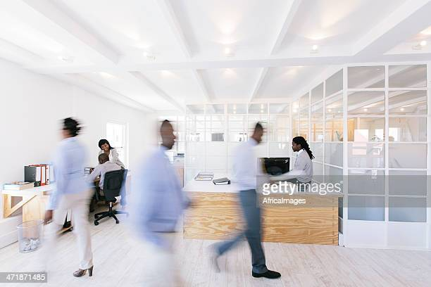 Busy African office with people walking around.