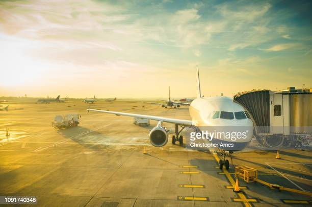 busy airport air travel - airfield stock pictures, royalty-free photos & images