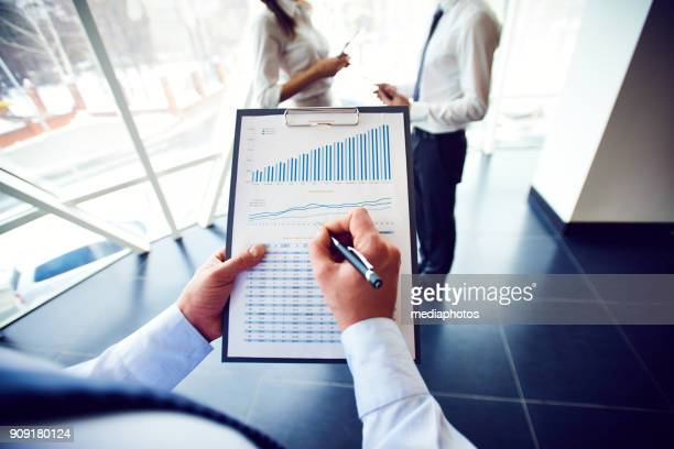 Busy analyst examining graphs