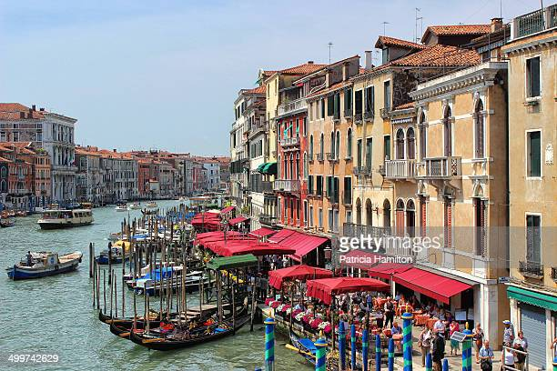 CONTENT] Busy area of the Grand Canal Venice viewed from the Rialto Bridge Cafes and gondolas Colourful scene UNESCO World Heritage Site Italy's main...