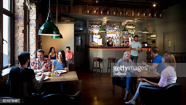 busy bar scene - diner stock pictures, royalty-free photos & images