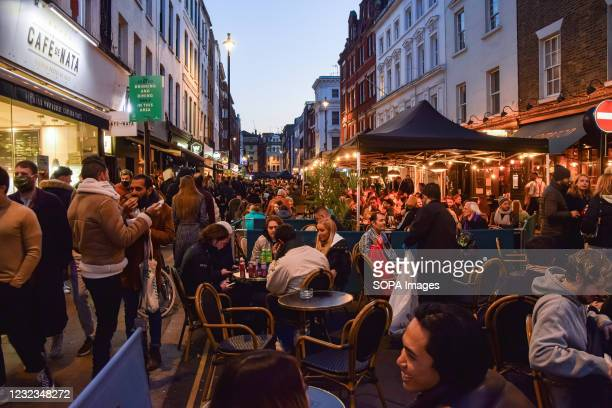 Busy bars and restaurants in Old Compton Street, Soho. Crowds of people packed the bars and restaurants in Central London on the first Friday since...