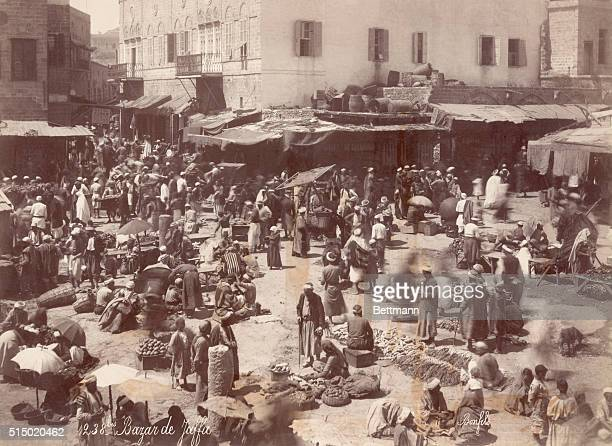 Busy bazaar in Jaffa a city on the Palestine coast of the Ottoman Empire