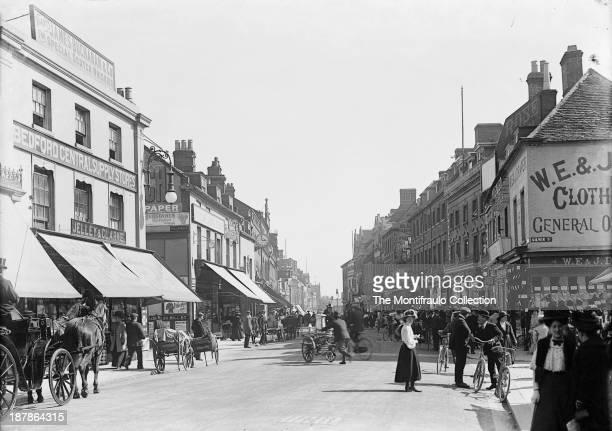 Busy Bedford High Street scene Bedfordshire England circa 1900