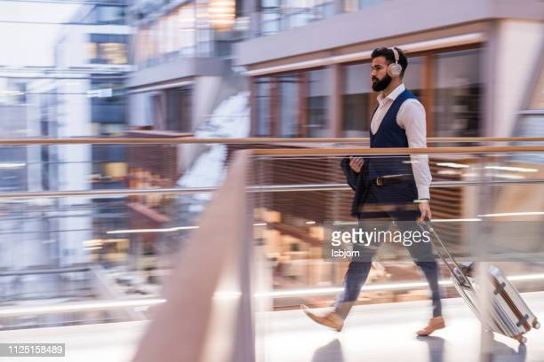busy businessman. - on the move stock pictures, royalty-free photos & images
