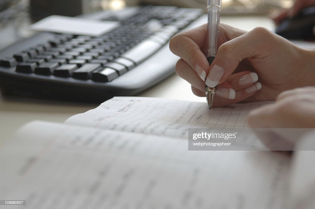Busy businesswoman's schedule : Stock Photo