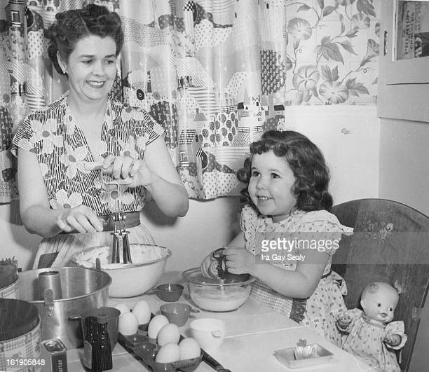 FEB 12 1952 FEB 13 1952 Busy CakeBaking Team Threeyearold Donna Lee Roger does her bit in preparing for the second annual carnival Friday at Stedman...