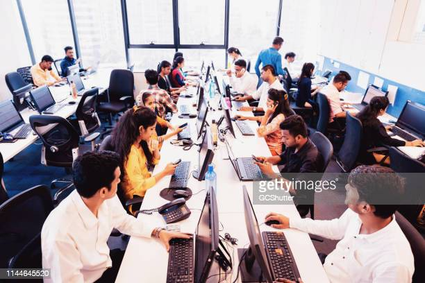 busy call centre in operation - indian ethnicity stock pictures, royalty-free photos & images