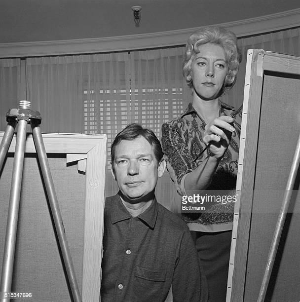Busy capturing their different images of Natalie Wood on canvas artists Walter and Margaret Keane work side by side in the actress' Bel Air...
