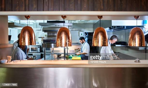 busy chefs working in commercial kitchen - busy stock pictures, royalty-free photos & images