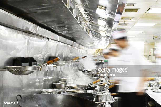 busy chinese restaurant kitchen. - restaurant kitchen stock photos and pictures