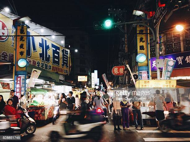 busy city street at night - taiwan stock photos and pictures
