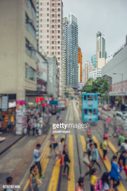 busy city,hong kong - pedestrian crossing sign stock photos and pictures