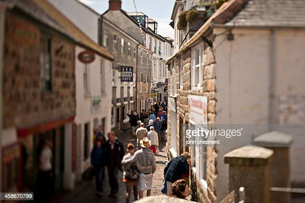 busy cobbled street in st ives cornwall - st. ives cornwall stock pictures, royalty-free photos & images