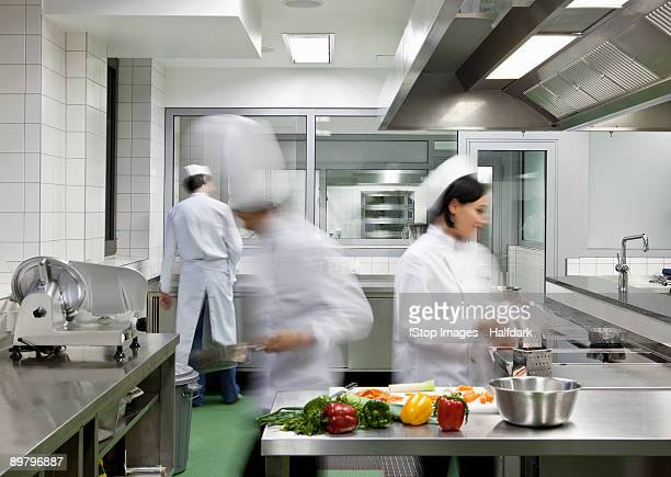 a busy commercial kitchen - female streaking stock pictures, royalty-free photos & images