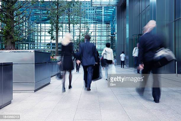 busy commute, blurred motion - office block exterior stock pictures, royalty-free photos & images