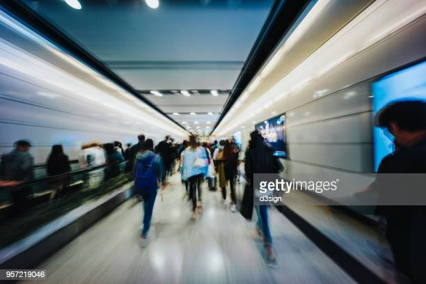 busy commuters in subway station during rush hour - railway station stock pictures, royalty-free photos & images