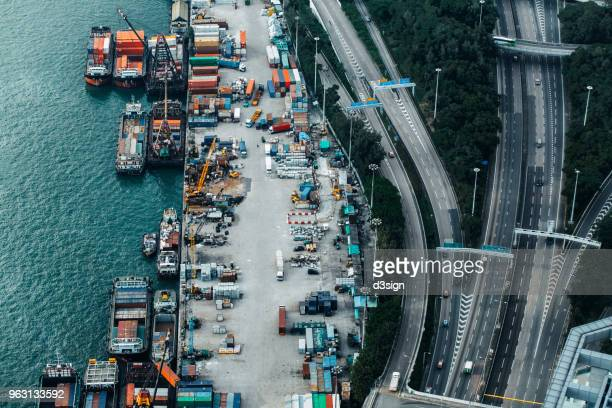 busy container cargo freight ship terminal in hong kong, china - oil prices stock pictures, royalty-free photos & images