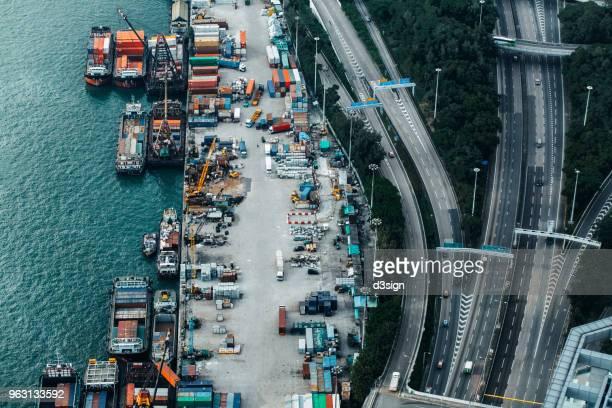 busy container cargo freight ship terminal in hong kong, china - comercializando - fotografias e filmes do acervo